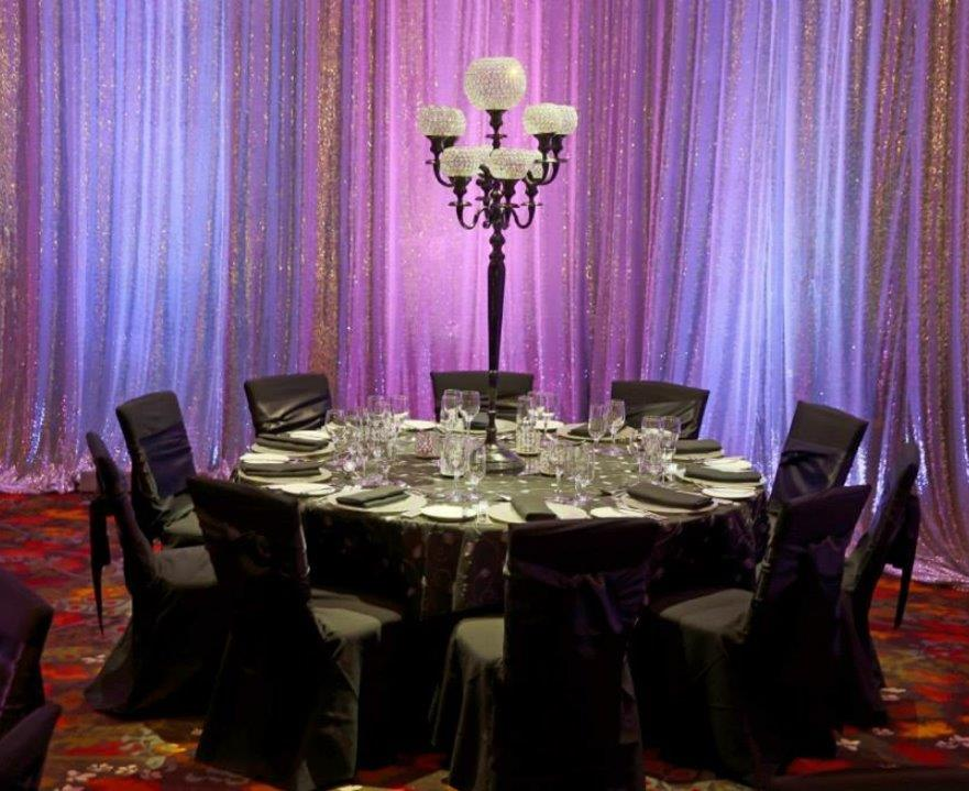 White Sequinned drapes with uplighting